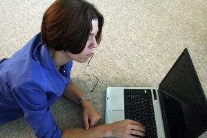 woman in blue on laptop