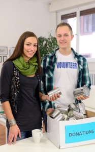volunteers with cans